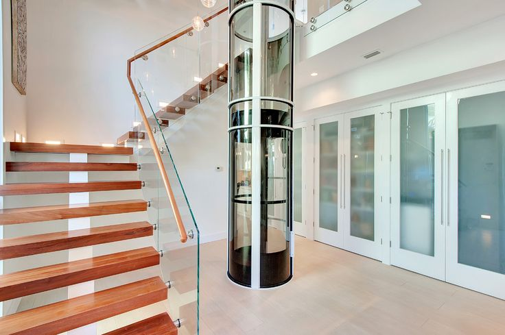 Residential elevator cost staircase contemporary with for Beach house lifts
