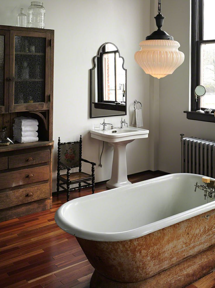rustic wood bath in large bathroom in an older home - nice wood floors and cabinet