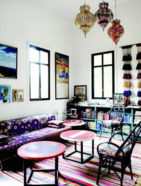Maryam's Bed n Breakfast Peacock Pavilions in #Marrakesh, #Morocco in the April issue of Elle Decor. I love this #colour-filled lounge room/library. The hanging #Moroccan lanterns mixed with the different rugs & fabrics draped around the room.