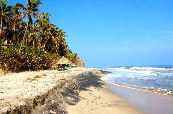 """Best Beaches - Palomino Beach, Columbia. """"Located on the Caribbean coast of Colombia in the foothills of the Sierra Nevada mountain (the world's highest coastal peak), Palomino is a mystical and unique place. It's the perfect spot to reconnect with yourself and enjoy Colombia's beauty."""""""
