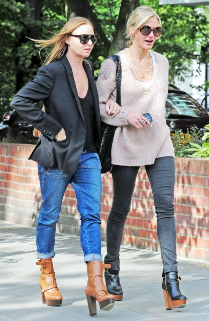 Cameron Diaz walking with Stella McCartney wearing Stella McCartney round sunnies, Stella McCartney Falabella Hobo bag, Stella McCartney oversized pullover, a Stella McCartney wooden heeled platform ankle boots & Stella McCartney stretch-cotton skinny jeans with zip ankle cuffs.
