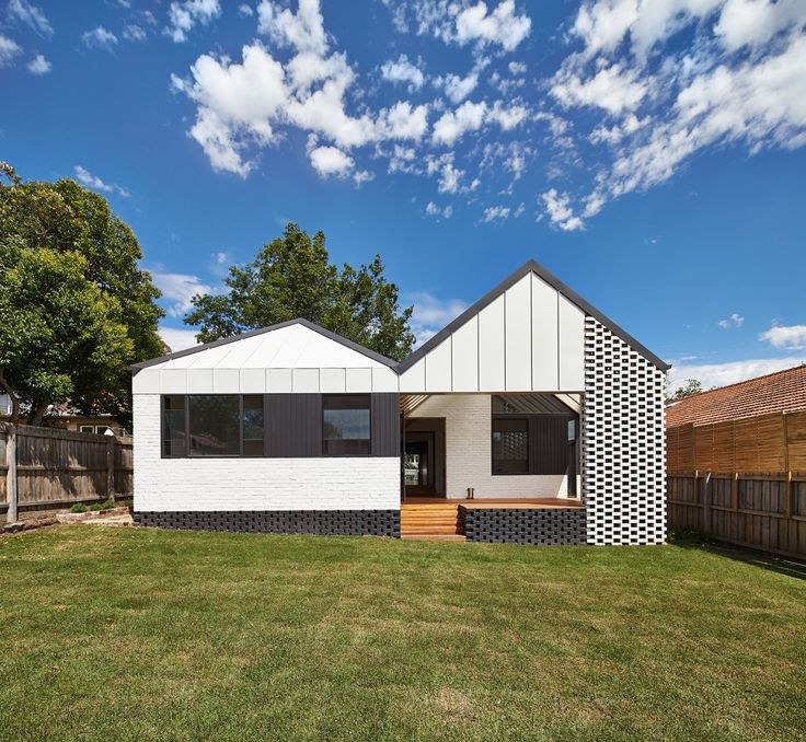A new hip roof rejuvenates a california style bungalow in for Cottage style homes melbourne