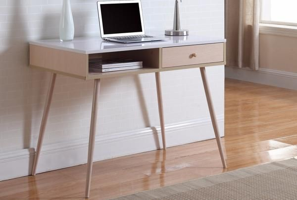 Ultra modern and contemporary yet timeless work desk. This sleek design will fit perfectly in your home office or a kid's bedroom. The desk features a touch of