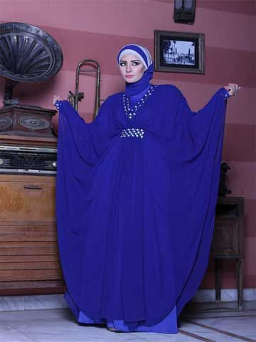 """Dona Abaya Butterfly style abaya made of two layers bottom is a separate Lycra lining  top is made of Chifffon Chiffon decorated beads under bust line around collar and cuffs. Hijab (scarf) included size  65cm x 175 cm /  25.6"""" x 68.9"""" Fabric: Chiffon and Lycra Washing Instructions: Machine Wash Tailored and designed by """" Donia Abayas by Donia hand beaded, never two abayas are exactly identical"""
