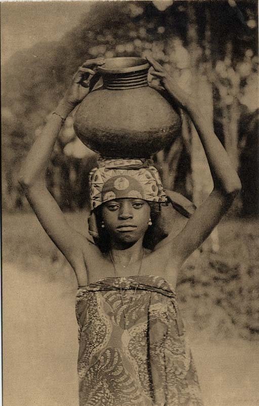 "African girl carrying water on her head, Congo, n.d. 	Missionary Postcards Yale University Divinity School Library New Haven, CT,  2006  Caption ""Waterdraagster."" From a set of labeled ""Apostolische Prefectuur van Coquilhatstad, Belgisch Congo - Dochters van O. L. Vrouw van het H. Hart - Missiezusters van Opwijck.""  Missionary Postcard Collection, Record Group No. 101, Special Collections, Yale University Divinity School Library."