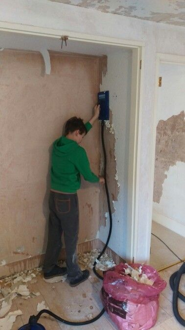When his bedroom is finished he'll be so satisfied to know he helped Daddy refurbish it! Here, stripping the wallpaper from his cupboard.