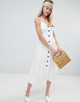 bad46f86b53 Shop the latest trends and styles with ASOS. Bershka button front dress in  white