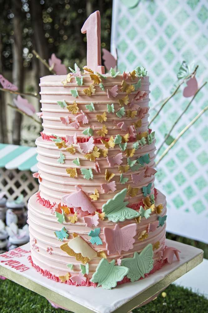 Wow! This butterfly 1st birthday cake is amazing!! You won't want to miss the enchanted party! See more party ideas at CatchMyParty.com