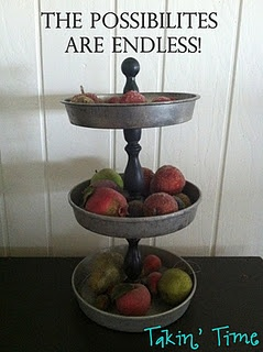tiered stand w/cake pans & wooden dowels...to hold fruit in the kitchen...to hold nailpolish and makeup in the bathroom :)