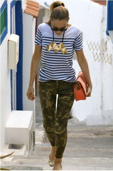 Shop this look on Lookastic:  https://lookastic.com/women/looks/crew-neck-t-shirt-skinny-jeans-ballerina-shoes-clutch-sunglasses-necklace/12729  — Black Sunglasses  — Gold Necklace  — White and Navy Horizontal Striped Crew-neck T-shirt  — Olive Camouflage Skinny Jeans  — Orange Leather Clutch  — Gold Leather Ballerina Shoes