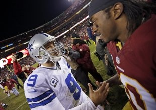 Tony Romo shares a moment with Robert Griffin III after the Redskins won the NFC East. (AP)