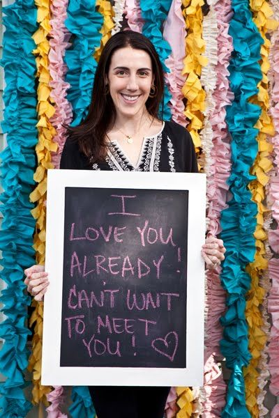 Such a cute idea! Have guests write a message to baby on chalkboard and photograph them. What a sweet keepsake!