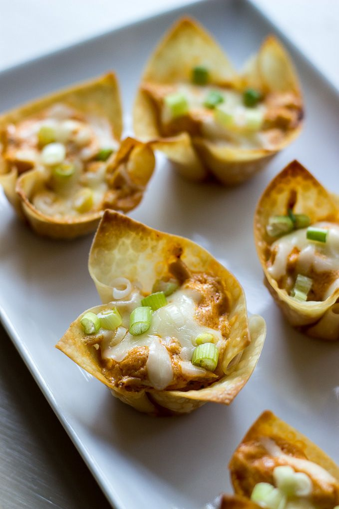 These Buffalo Chicken Wonton Cups are the perfect game day appetizer. They've got all the spicy flavor of traditional wings, minus the mess!