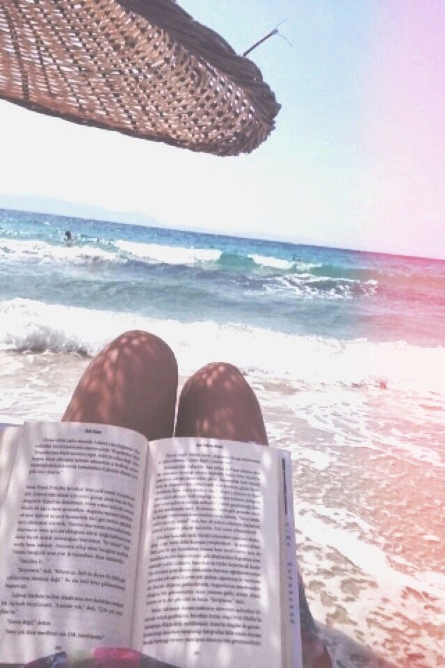 reading a book by the sea