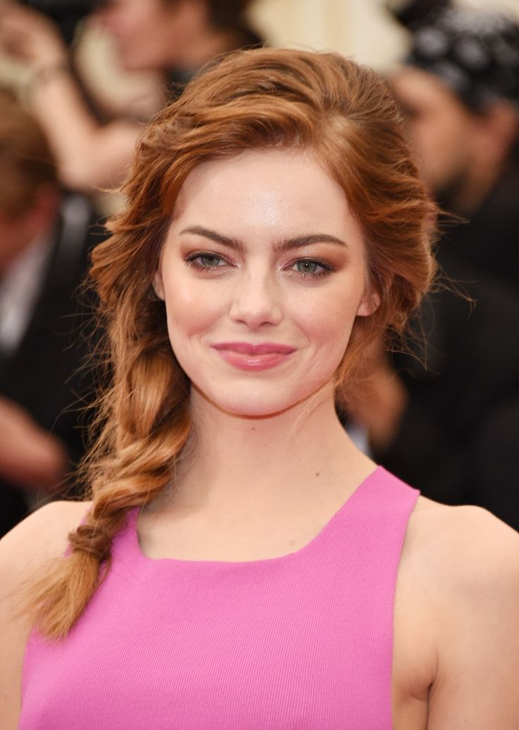 At the 2014 Met Gala, Stone wore her hair softly tousled in a side braid and a shimmery, bronze smokey eye.