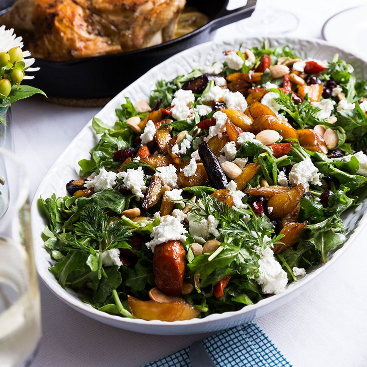 Roasted carrots, goat cheese and cranberries come together in this vibrant fall salad from Ina Garten.
