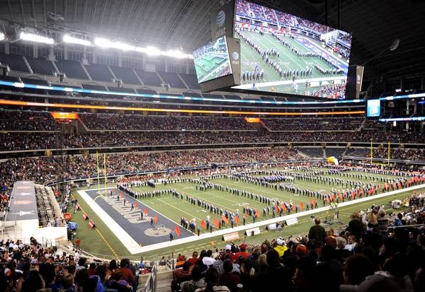 The Allen Eagle Escadrille, with more than 840 members, performs during halftime of a UIL Class 5A Division I high school football championship game against Houston Lamar, Saturday, Dec. 22, 2012, in Arlington, Texas.
