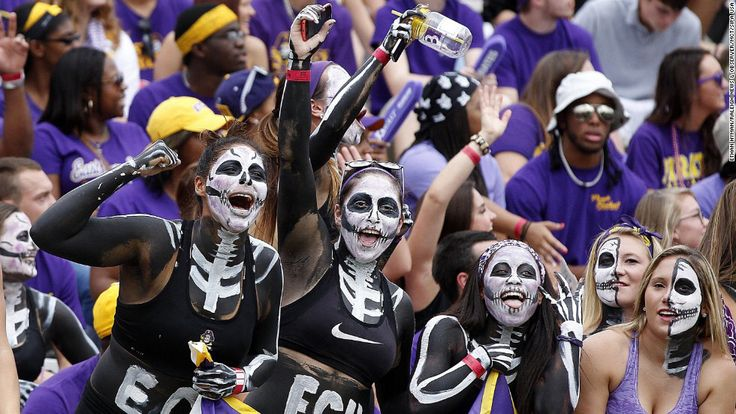 Fans of the East Carolina football team cheer on their Pirates before a home game Saturday, September 20, 2014, in Greenville, North Carolina. East Carolina trounced the visiting North Carolina Tar Heels 70-41. (CNN.com)