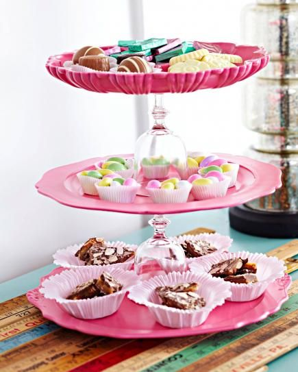 Tower of treats ... Two old wine glasses and three pretty plates make for a display stand for sweets. Use Poster Putty to secure the glasses if you don't want this to be permanent.