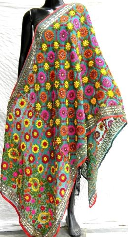 Steal the show at the next party you attend in this stunning sea green phulkari work poly georgette dupatta. It has been heavily embroidered in a vibrant colored floral pattern, with wool thread and sequins. - See more at: http://giftpiper.com/Handmade_Phulkari_Georgette_Dupatta_Sea_Green-id-224990.html#sthash.09nlw19q.dpuf