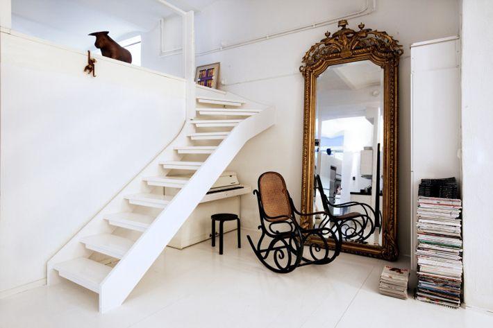 Full-length mirrors against walls.