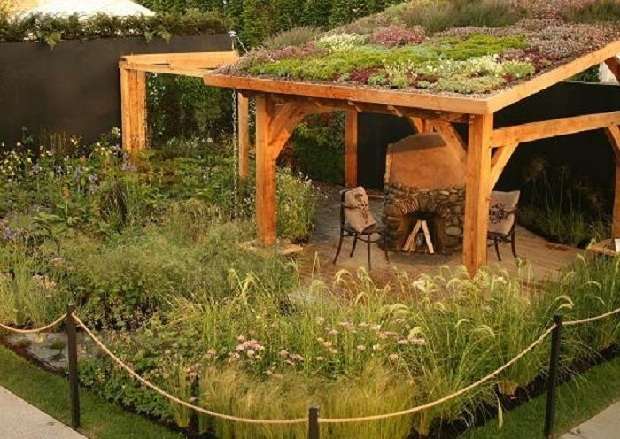 This cob oven was made by Hendrik Lepel.It is protected with a living roof. If more tilted, could possibly be built as a carport/garden; esp. if had steps up and enough support.