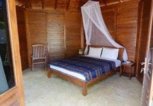 That is the bedroom in one of the four teakwood bungalow in Ayu Hotel Karimunjawa.