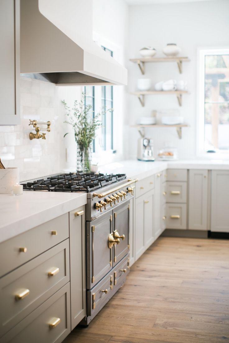 light gray cabinets with gold hardware vintage range open shelving next to sink pot filler on kitchen cabinets gold hardware id=15429