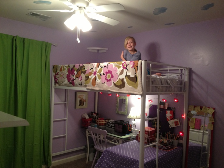 Lofted bed with craft center and vanity underneath for