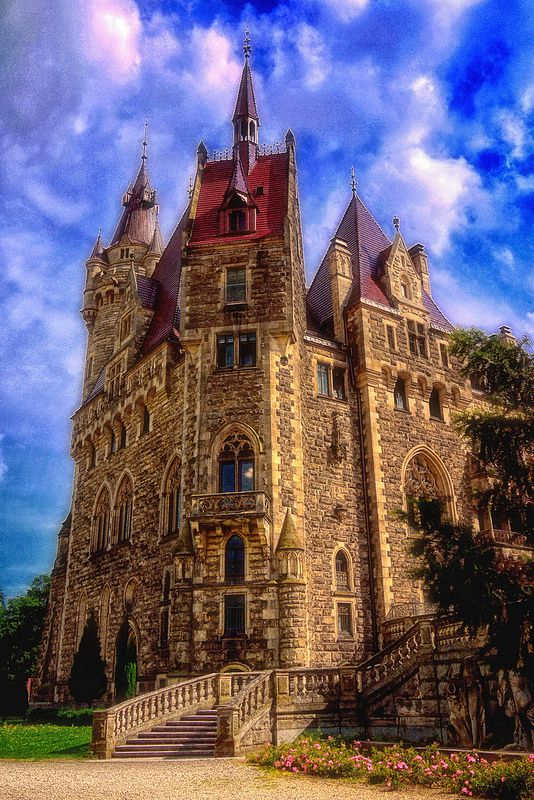 Moszna Castle - Moszna, Poland / Dating back to the 17th century the castle is eclectic architecturally.  In 1945 the last private residents had to leave and the castle was occupied by the Red Army. Renovated and well kept it now is a medical and mental health facility.  It is open to visitors.  It has 395 rooms and 99 turrets.