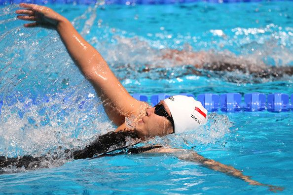Li Tao of Singapore competes during the Women's 100m Backstroke Preliminaries heat three on day ten of the 15th FINA World Championships at Palau Sant Jordi on July 29, 2013 in Barcelona, Spain.