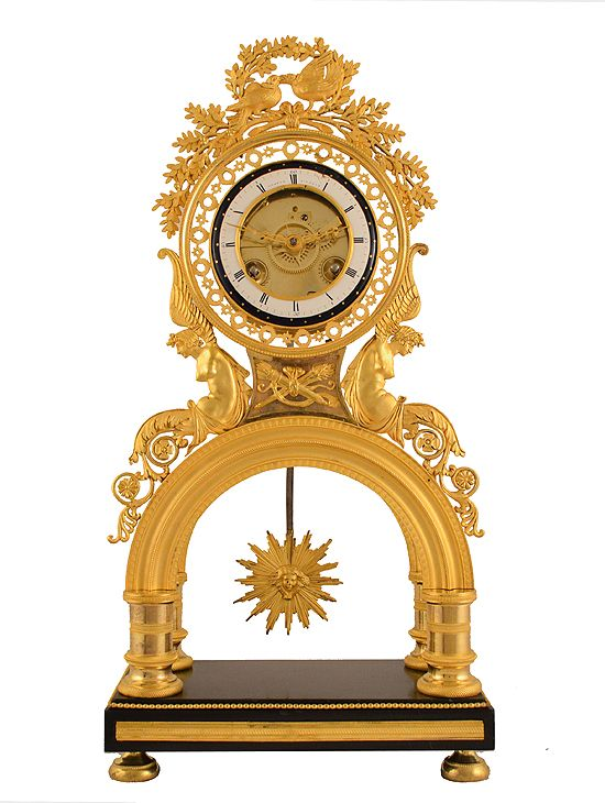 Rare #skeleton #portico #clock in ormolu #Directoire, period 1795 -1799. Prestigious signature of the great watchmaker Chopin in Paris. Architecture based on a double carved arch animated by a nice radiant wheel-balance. White enamel dial-plate surrounded by a double frame: a blue one decorated with stars, and an openwork bronze one. Top decorated with foliage and swallows, rectangular black marble ornamentation carved frieze and a string of pearls. For sale on #Proantic by Clock Prestige.