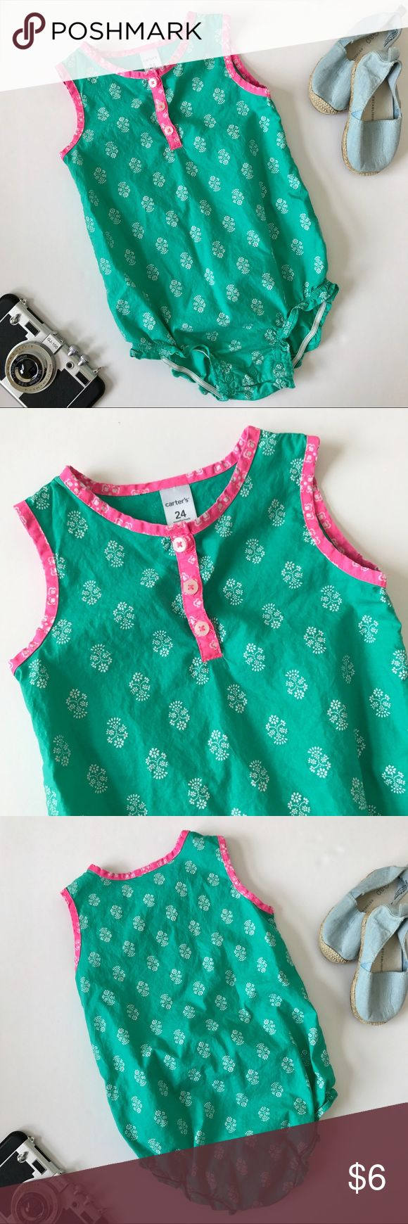 Carter's Sleeveless Bodysuit Blouse (Girls 24 Mos) Keep her as cool as she is cute this summer in this sleeveless bodysuit romper from Carter's. Features bright teal green and fuschia pink floral print, three button closure at neckline, snap bottom for easy dressing and changes, and elasticized leg openenings. EUC. Girls size 24 mos.     ▪️Next day shipping from a smoke & pet-free home.   ▪️No trades, always open to offers, and all photos are of actual item. Carter's One Pieces Bodysuits
