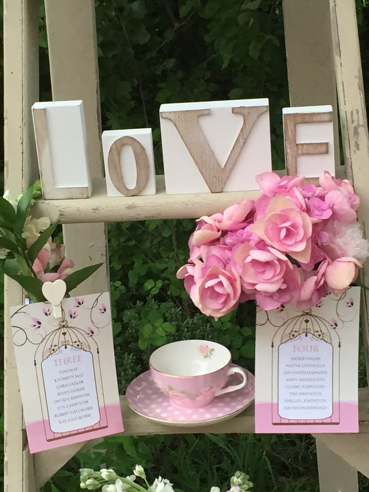 Hire love signs and vintage crockery to add to your vintage table plan ladder.
