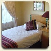Offering 51 en-suite rooms in townhouse style apartments, ranging from single to King Leisure, Twin and Deluxe.  All rooms are comfortably appointed with air-conditioning and large bathrooms.  A workstation is provided with international plug points, television with SABC, Mnet  & DSTV channels, mini bar and tea making services. Free WIFI connectivity throughout the hotel and conference centre