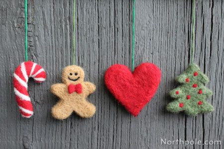 Use cookie cutters to make these needle felted Christmas ornaments. Needle felted projects like this one don't take long to complete, so you can easily make several to give away as presents!
