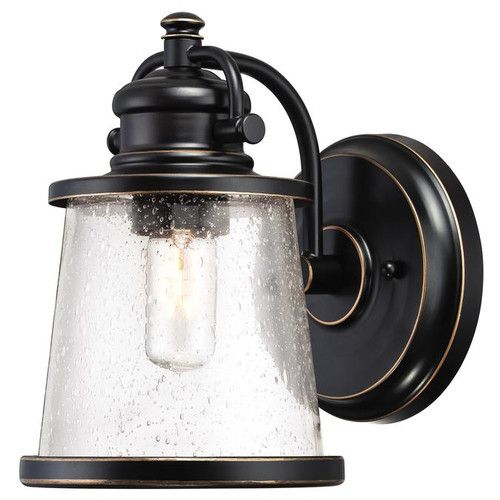 Features: -1-Light outdoor wall lantern with a hint of coastal style. -Amber bronze finish with highlights on steel; clear seeded glass. -Uses 1 medium-base bulb, 60-watt maximum (not included) or