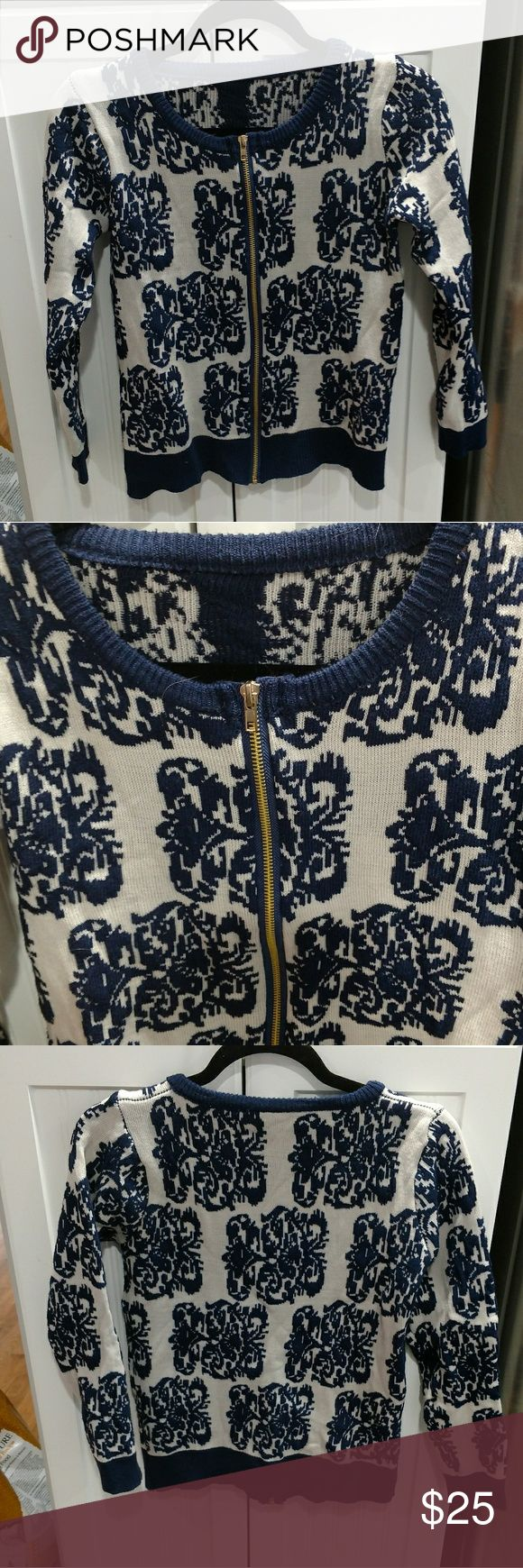 Zip up cardi Beautiful blue and white zip up cardigan print is blue and white there are no tags I bought it from another posher but it's too small ?? fits about a 2-4 Sweaters Cardigans