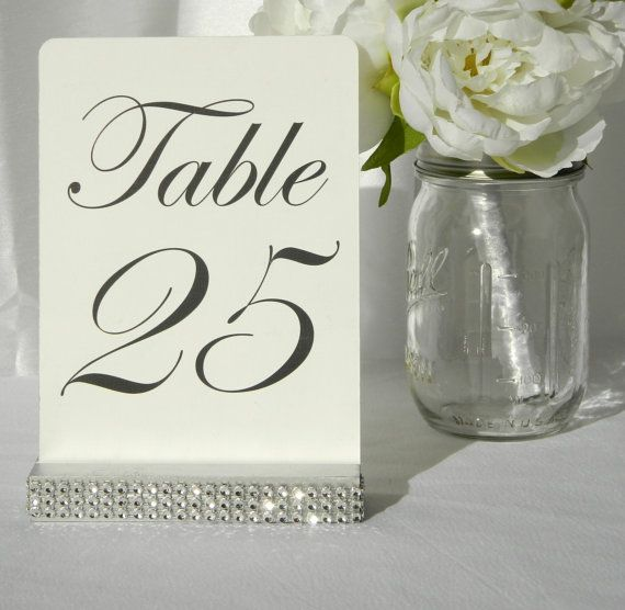 Set of 10 Silver Holders table number holders, the holder has been wrapped with a crystal wrap ribbon (please note: The crystal wrap does NOT include