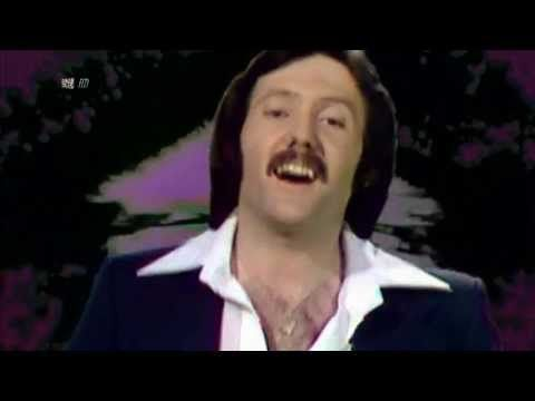 """Save Your Kisses For Me"" by Brotherhood of Man - This song represented the UK at the Eurovision Song Contest 1976 & won the competition. I have always liked it since. :-) Listening to it has made my heart be shiny and feel joyfull. Nice pop song! So 70's & so British!"
