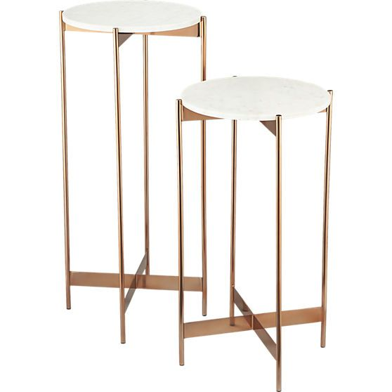 White marble floats effortlessly on svelte metal legs in elegant display ideally sized for art or botanicals. Stainless steel base warms in rose gold lacquer with ridged cross-bar support.