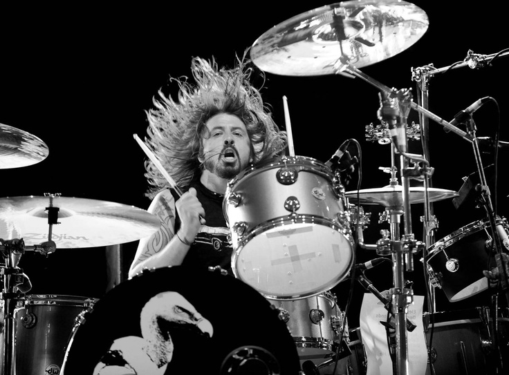 Dave Grohl beating those drums as only he can http://drumsbomb.com/