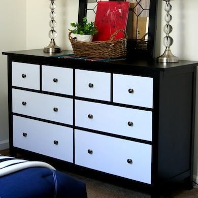 Old dressers can often be had for cheap at tag sales and used furniture stores. Make them look like a million bucks for just about $10 more by refacing the drawers with contact paper.