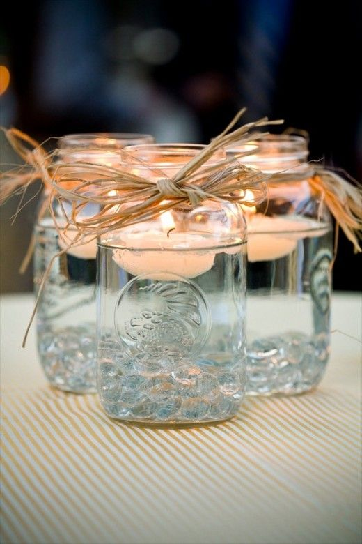 Floating candle in mason jar [DIY] - grab some mason jars. Fill one third or one fourth of the jar with pebbles, marbles, sand, shells, petals, whatev you find. Fill with water. Place candle in water. Light candle. Kick back and enjoy.