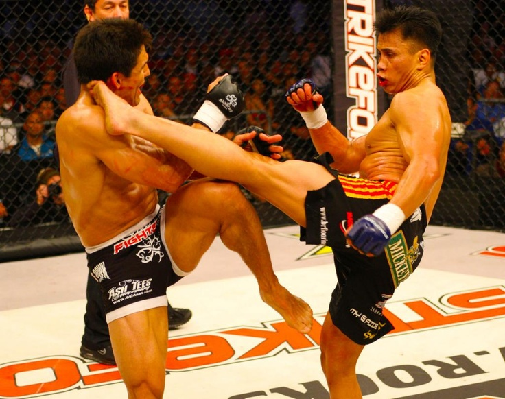 Frank Shamrock vs. Cung Lee. Frank made a huge mistake trying to trade with Cung, instead of grappling. Cung Lee dominates him on their feet, and even shatters his arm with a roundhouse kick!