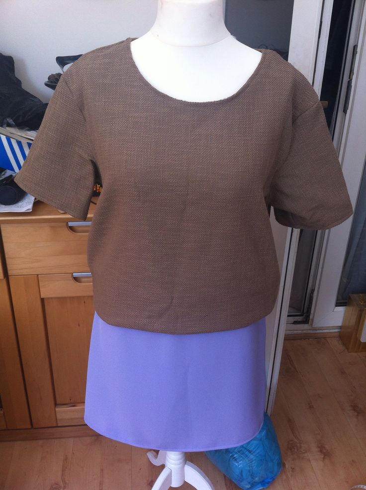 Beige woven t shirt and lilac skirt