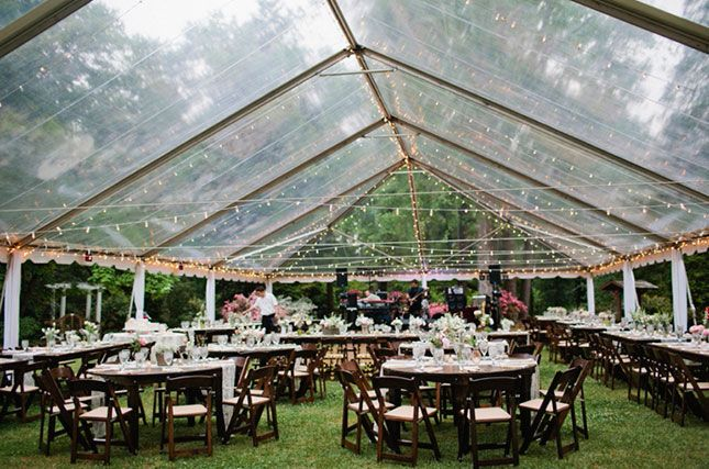 Rainy wedding day? Make sure you have a tent rental on speed dial.