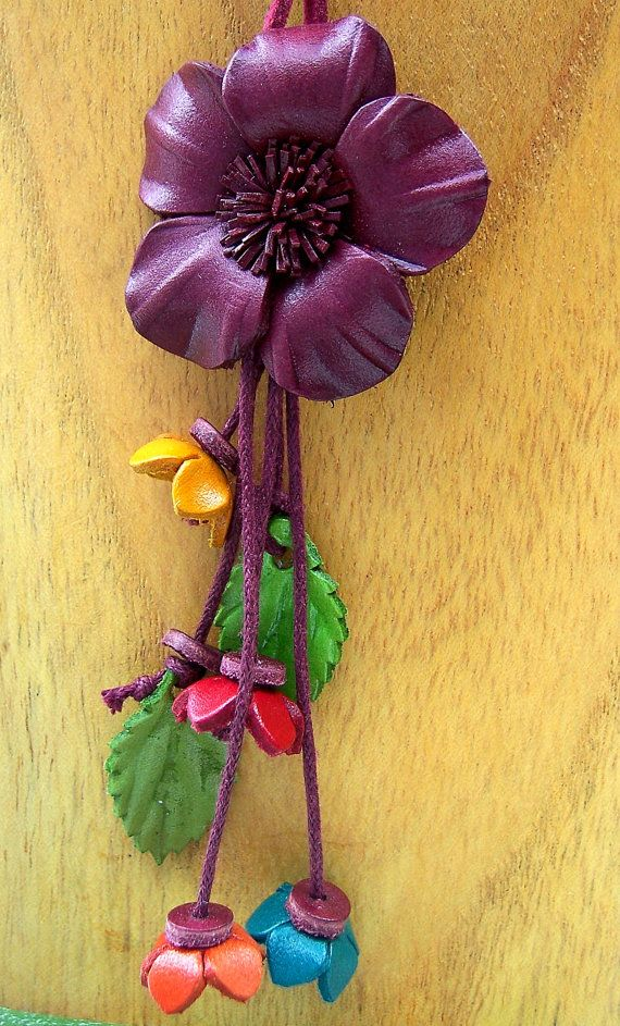 Leather flower pendant on suede cording by PumpkinMoonDesigns,