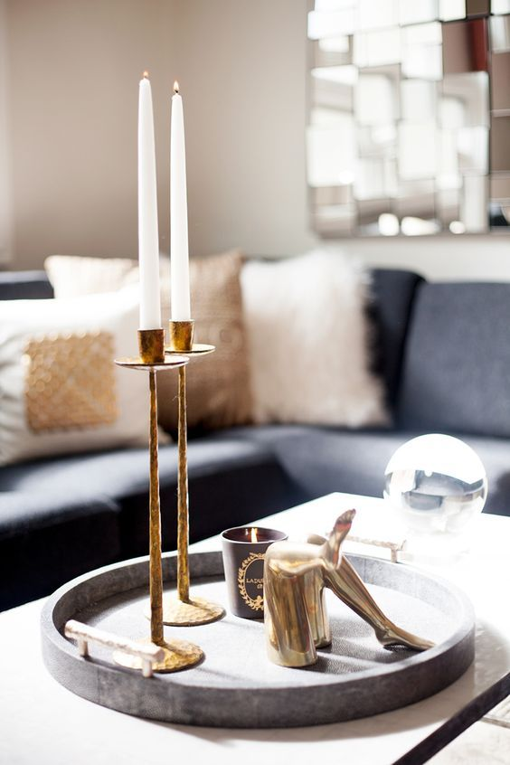 12 Gorgeous Coffee Table Styling Tips Every Girl Should Know   Give your coffee table a makeover with these brilliant decor ideas   Round tray + candlesticks and decorative objects