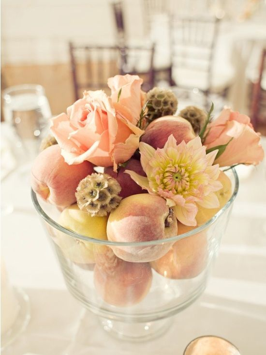 Peach and flower wedding centerpiece idea.